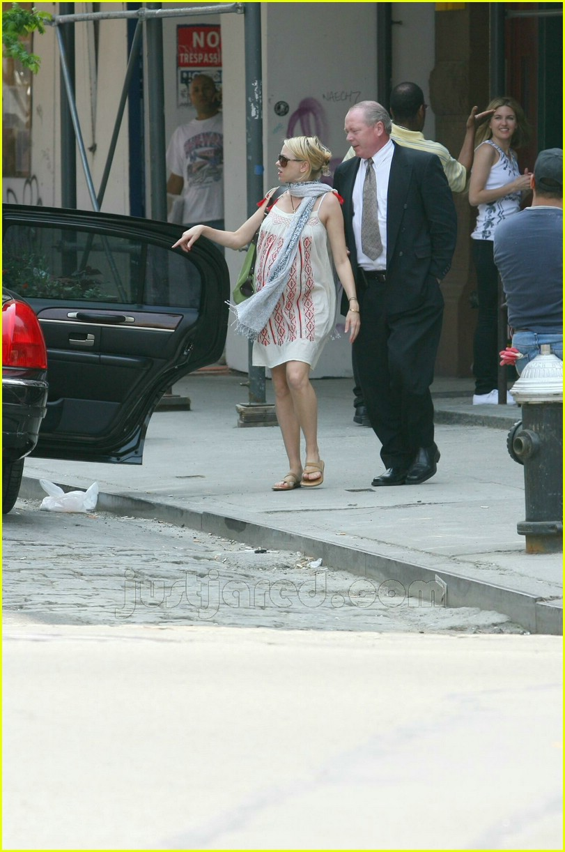 ... (left) looking very very pregnant on Thursday in New York City.