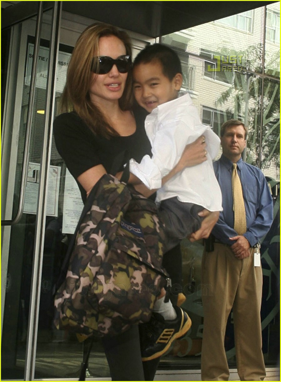 angelina jolie carrying maddox 10