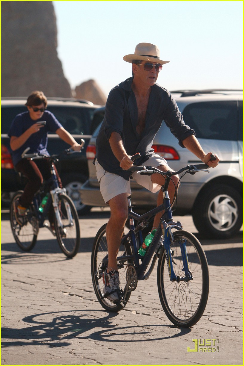 pierce brosnan beach bicycling 092386942