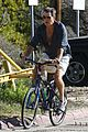 pierce brosnan beach bicycling 10