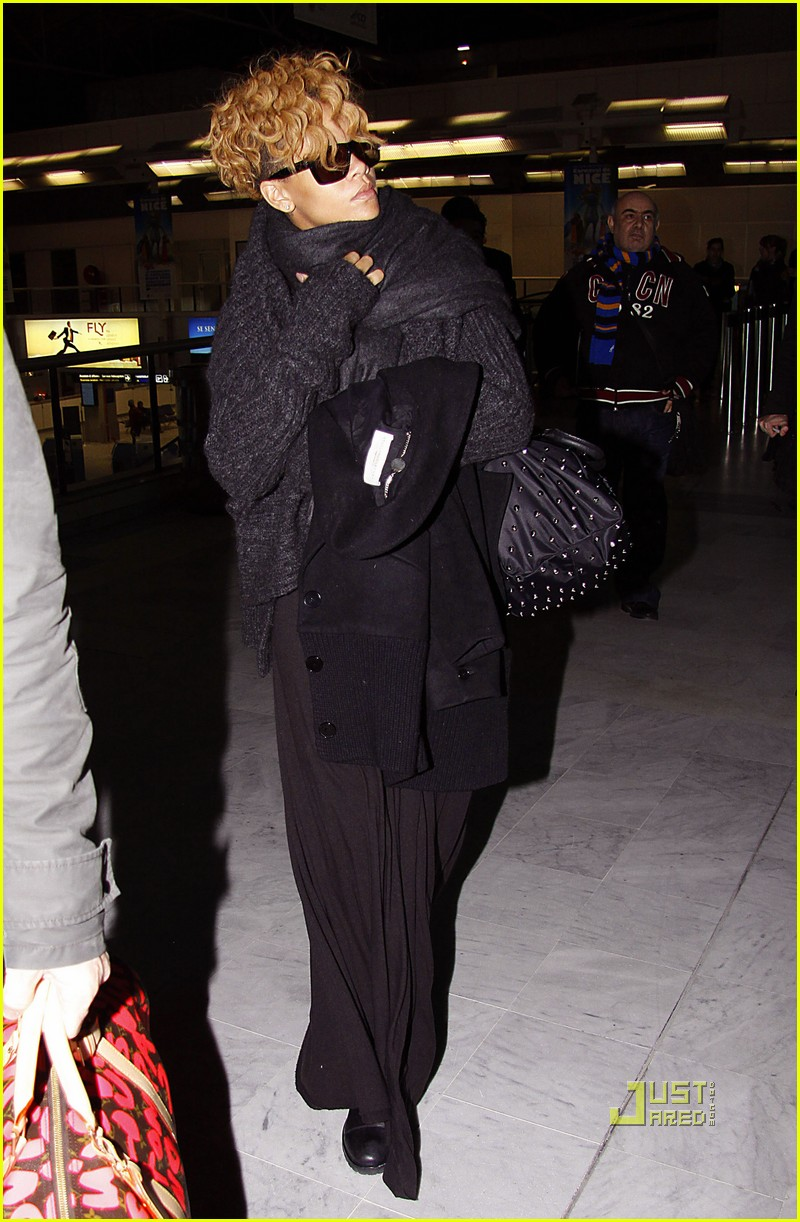 rihanna departs nice airport after nrj awards 04