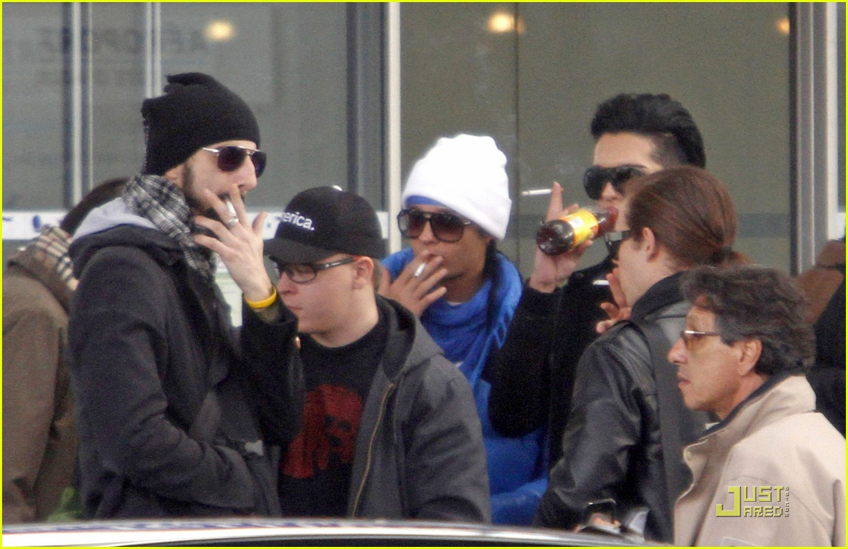 Tom Kaulitz smoking a cigarette (or weed)