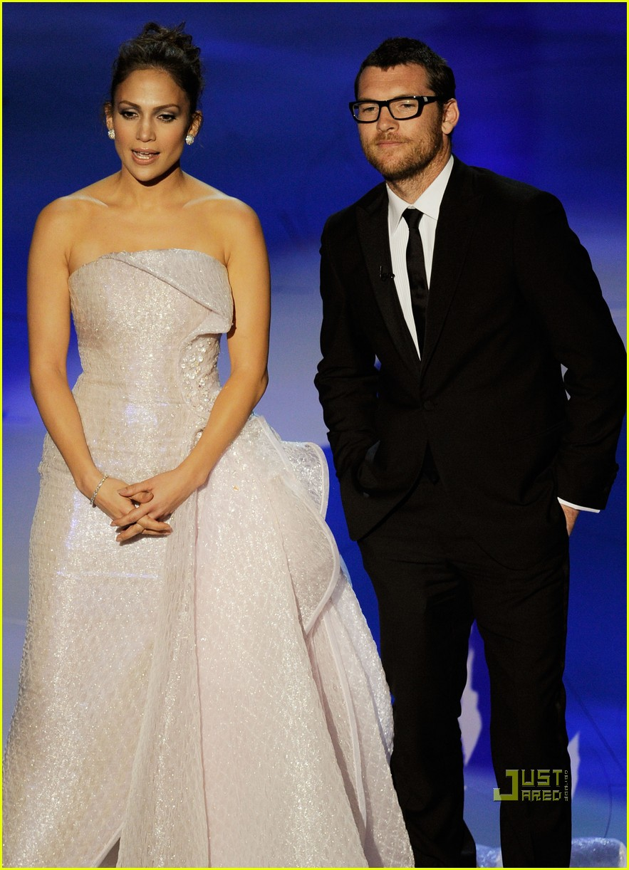 sam worthington natalie mark 2010 oscars red carpet inside 06
