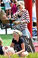 gwen stefani swinging with zuma 07