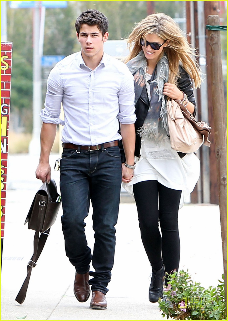 nick jonas delta goodrem holding hands 03