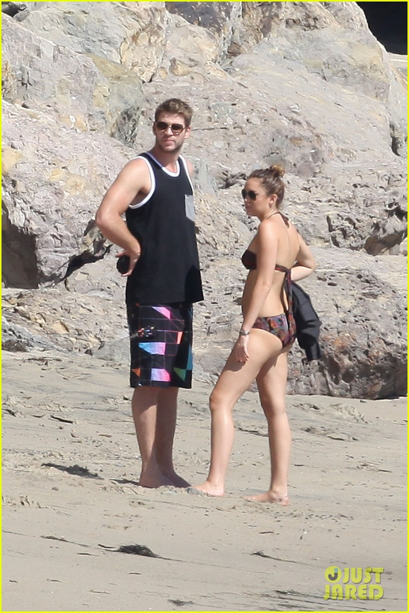 Miley Cyrus in Red Bikini and Liam Hemsworth at the beach in Malibu Pic 34 of 35
