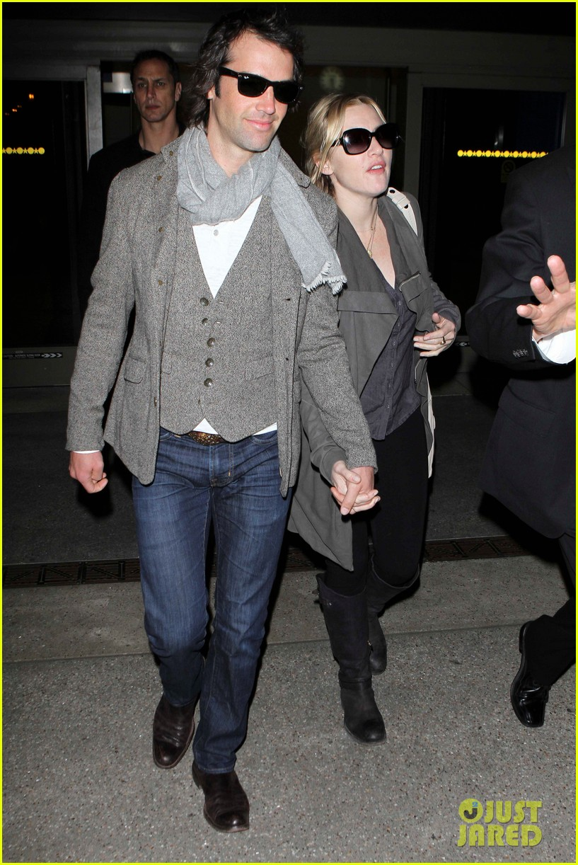 kate winslet ned rocknroll hold hands lax 02