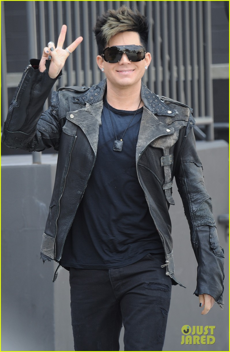 adam lambert peace sign out 01
