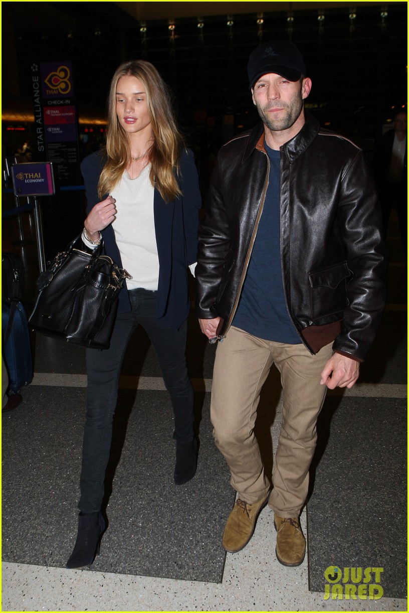 rosie huntington whiteley jason statham holding hands lax 032635097
