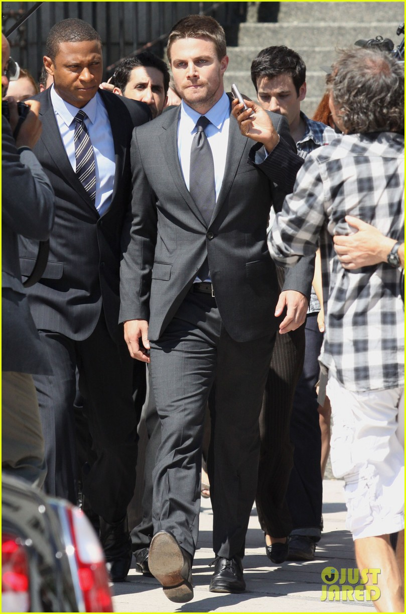 stephen amell suits up on arrow set 23