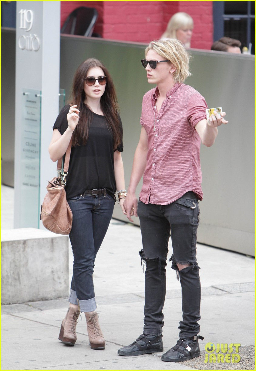 lily collins jamie campbell bower hold hands toronto 03