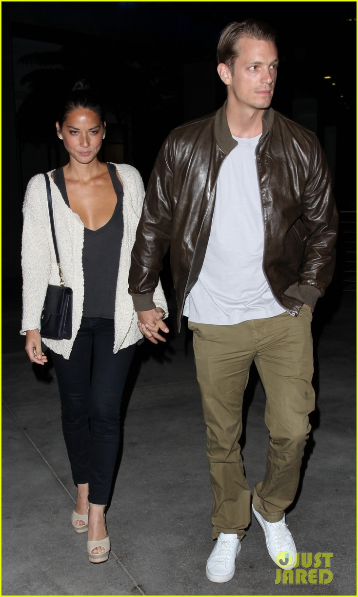 olivia munn joel kinnaman holding hands at the movies 05