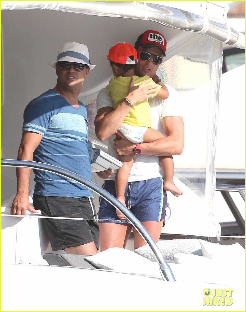 Cristiano Ronaldo Holds Onto His Son Cristiano Jr While ...
