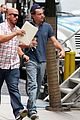 leonardo dicaprio hides under umbrella on wolf set 08
