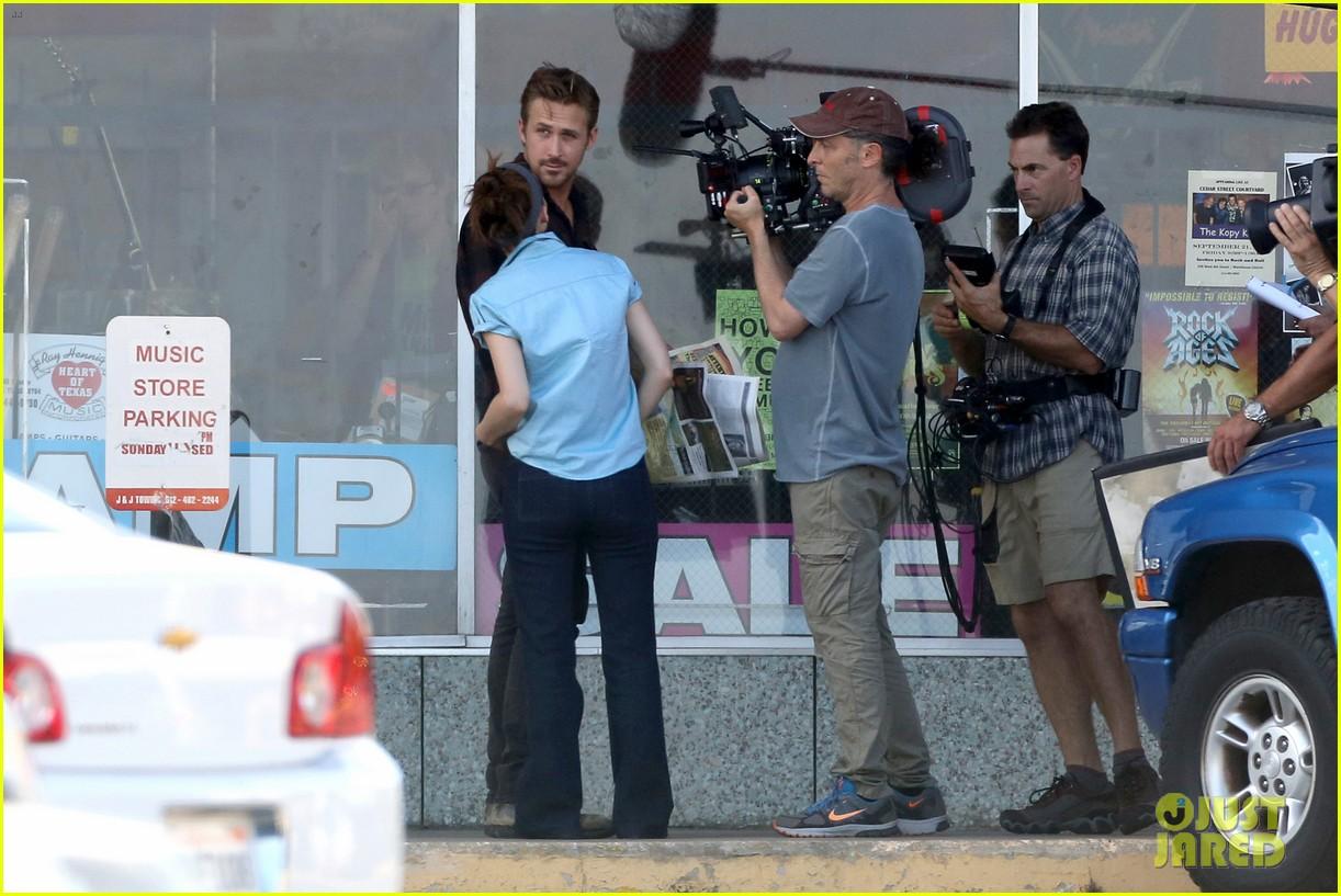 Full Sized Photo of rooney mara pushes ryan gosling face on malick set ... Ryan Gosling