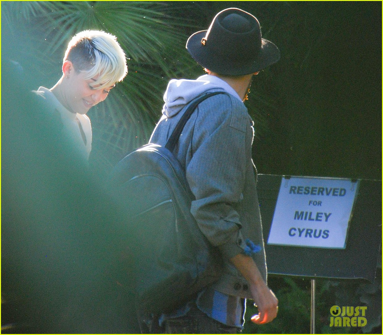 miley cyrus hits the studio liam hemsworth breaks a sweat 042756502