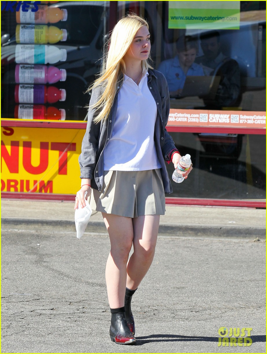 elle fanning showing some leg 12