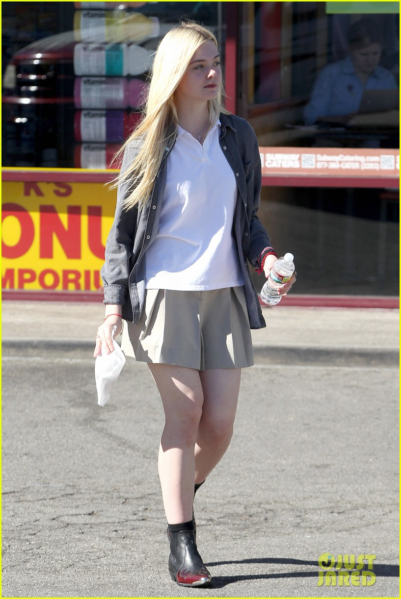elle fanning showing some leg 18