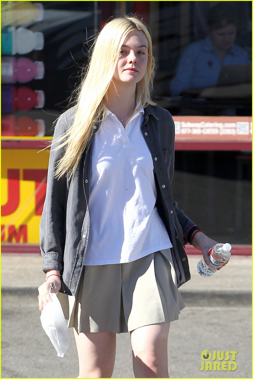 elle fanning showing some leg 19