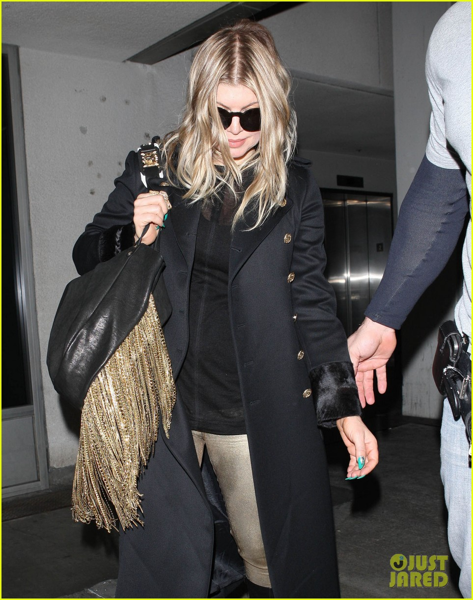 fergie pointy green nails at lax 10