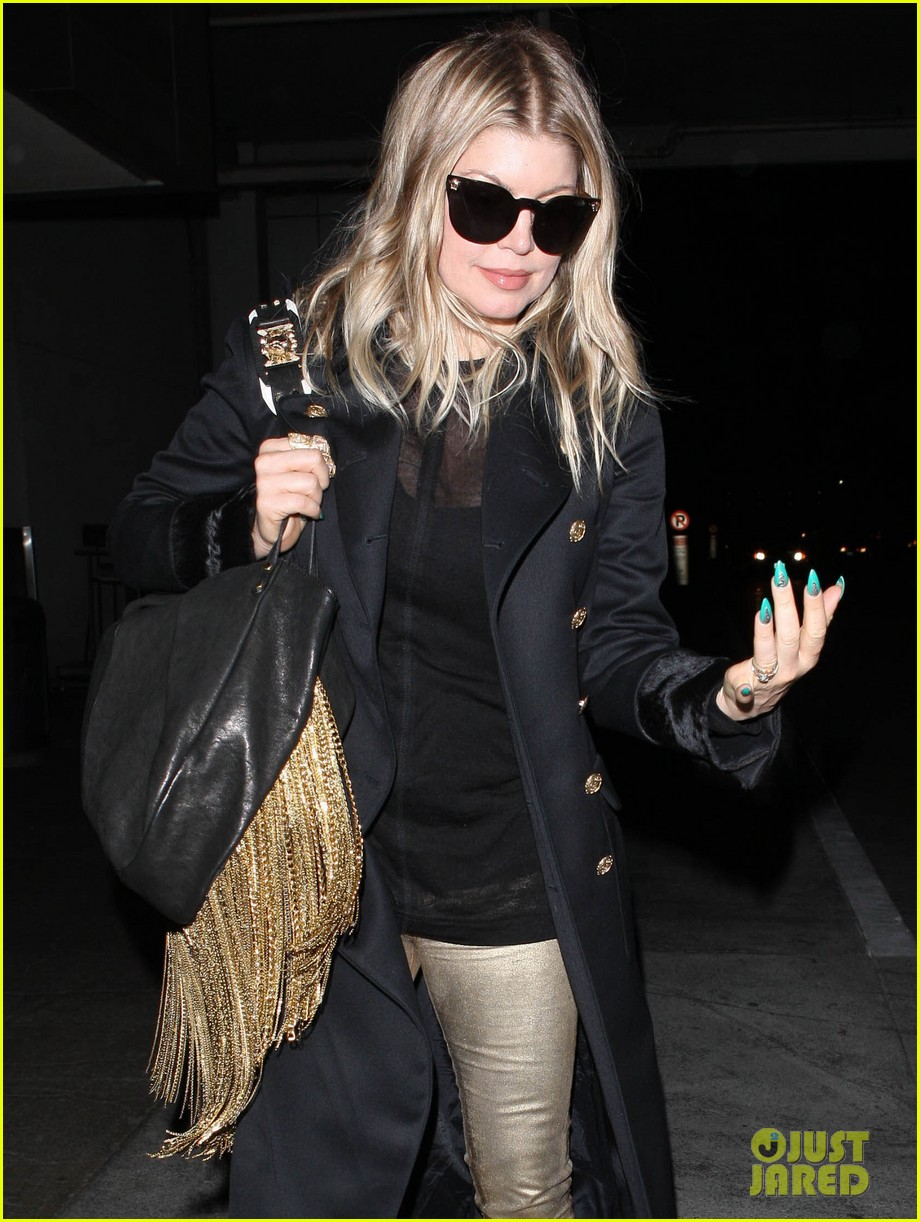 fergie pointy green nails at lax 11