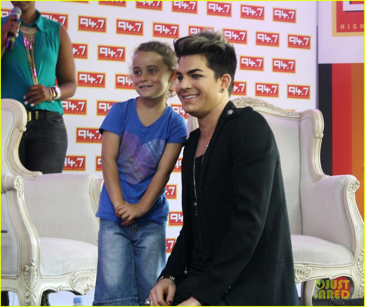 adam lambert hugs lucky young fan in south africa 03