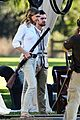 emily vancamp shoots rifle on revenge set 01