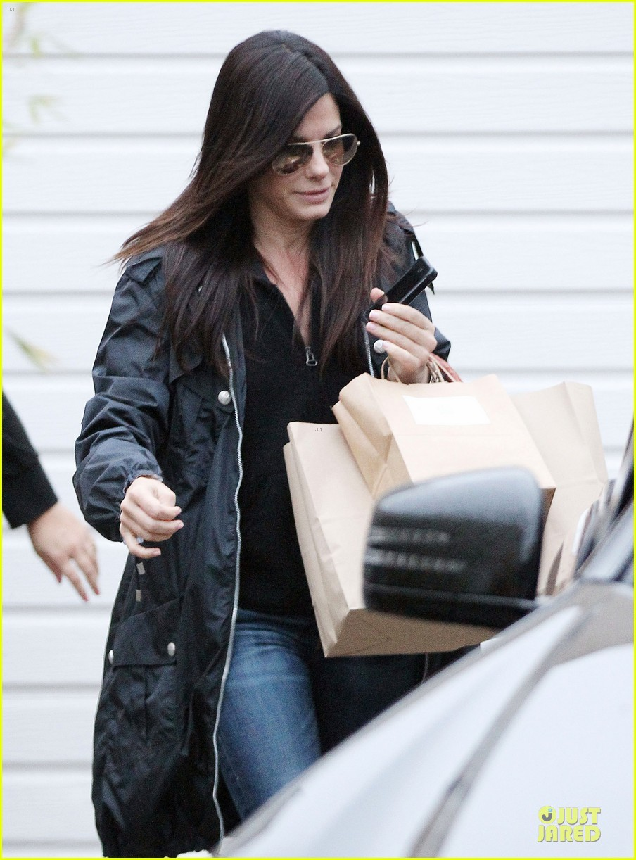 sandra bullock school drop off with rain boots 11