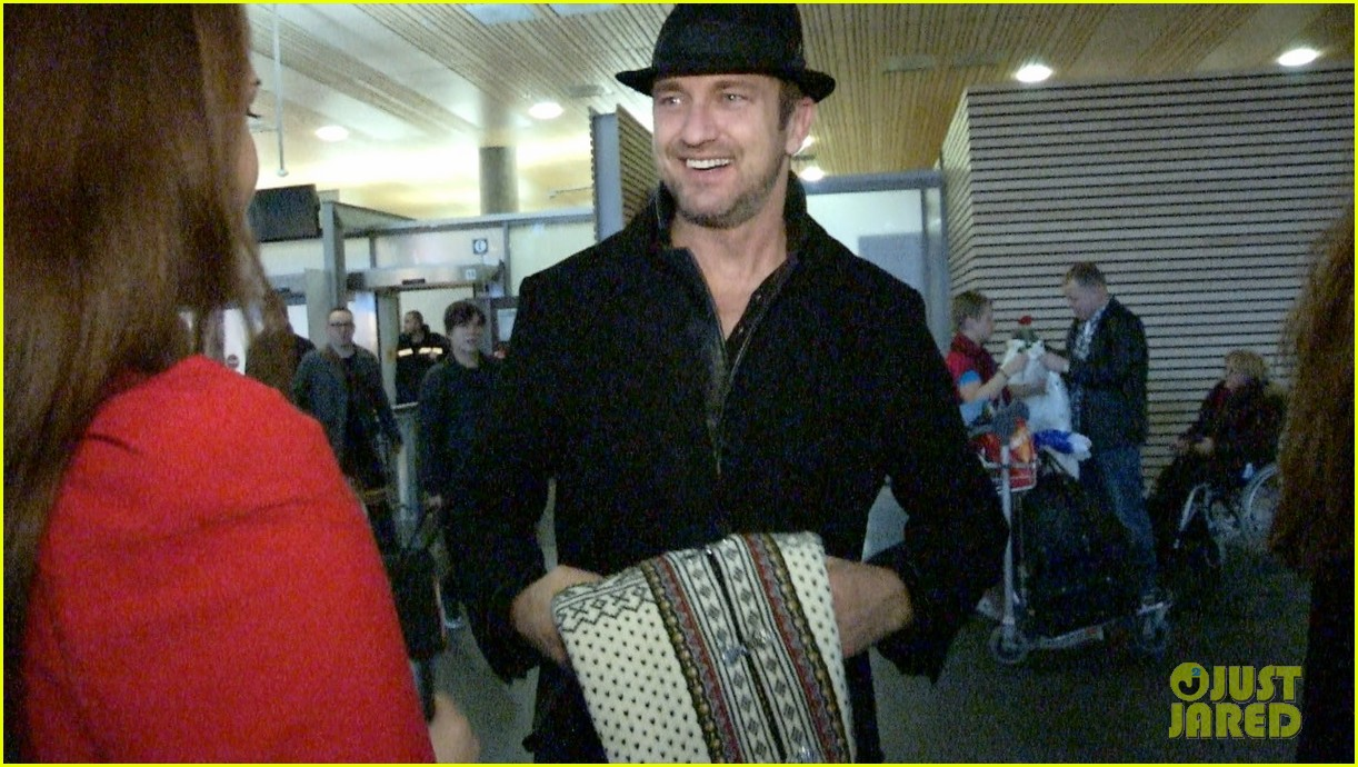 gerard butler norway arrival with madalina ghenea 02