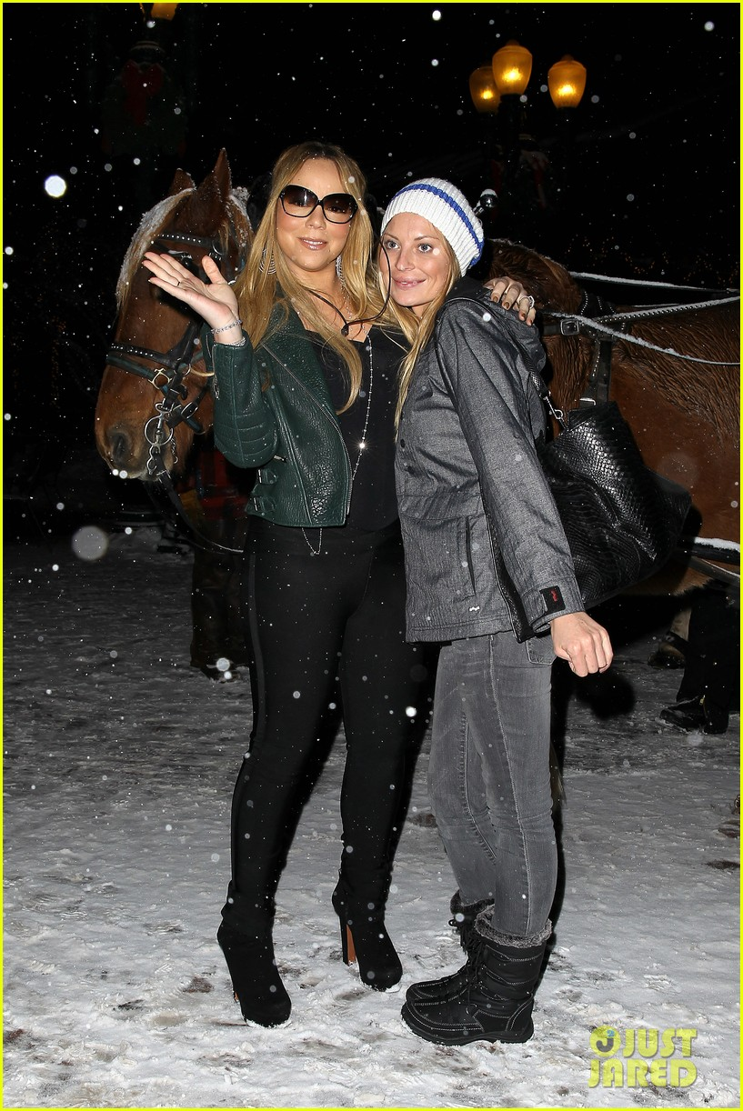 mariah carey giving away santa hats to lambs 03