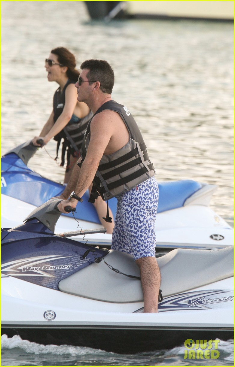 simon cowell jet skiing with former fiancee mezhgan hussainy 01