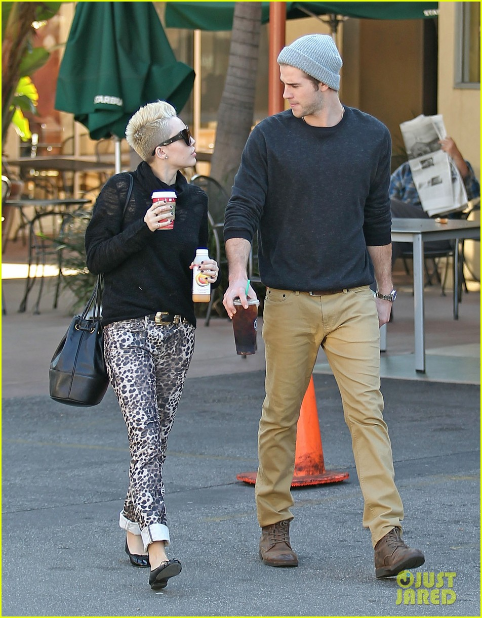 miley cyrus liam hemsworth holding hands at starbucks 052779797