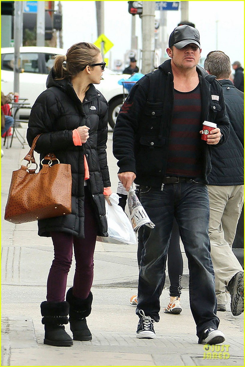 annalynne mccord & dominic purcell coffee strolling couple 042777155