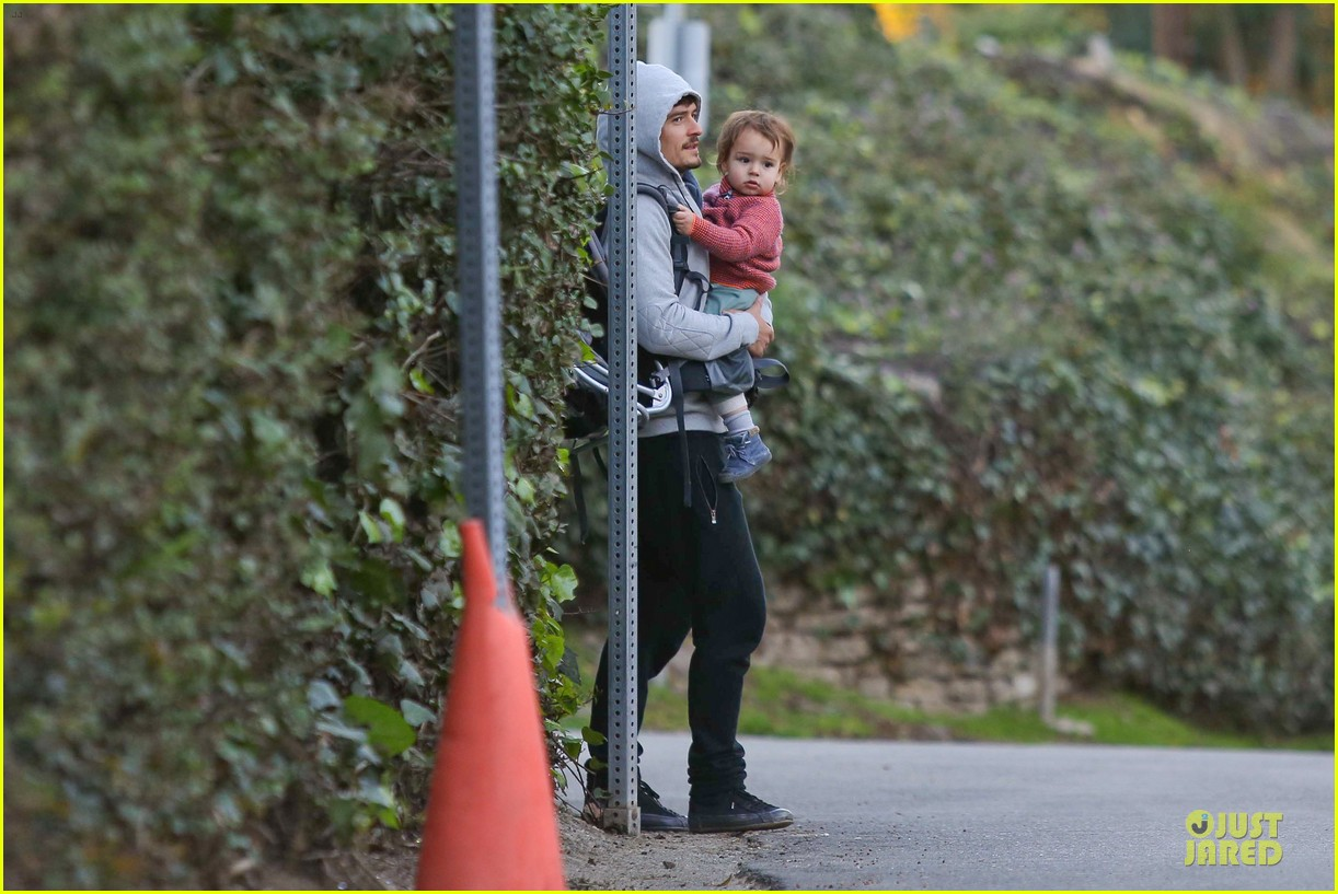 orlando bloom walks home with flynn 122784117