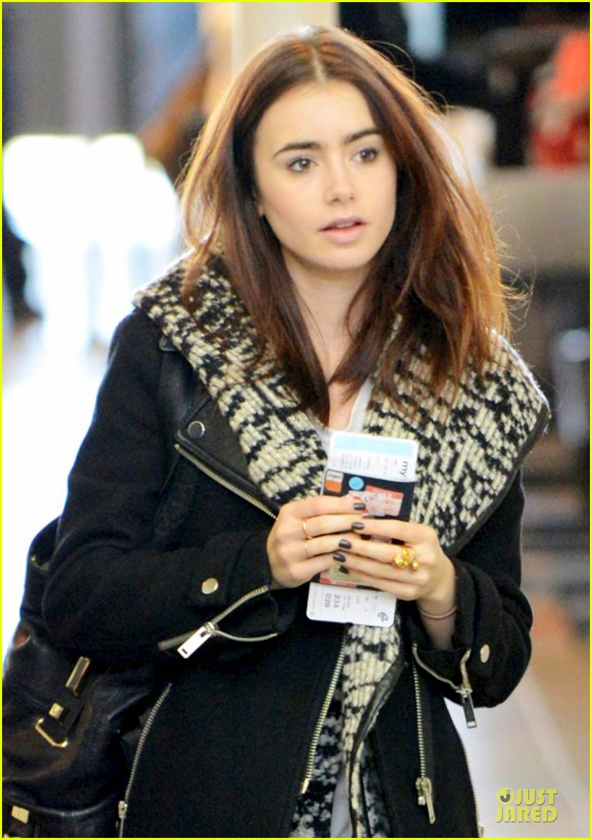 lily collins passport departure at lax airport 02