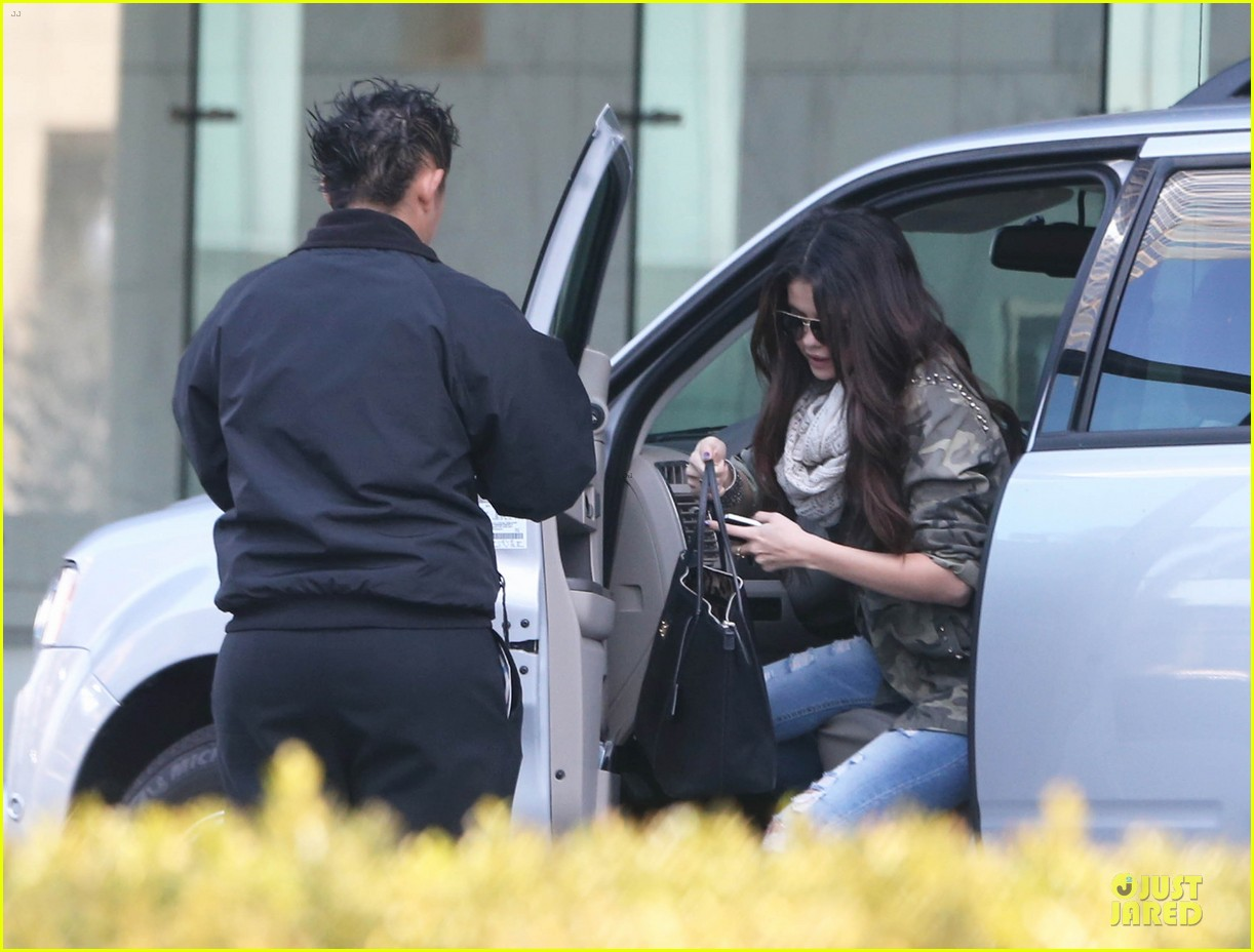 selena gomez office day with vanessa hudgens 102787357