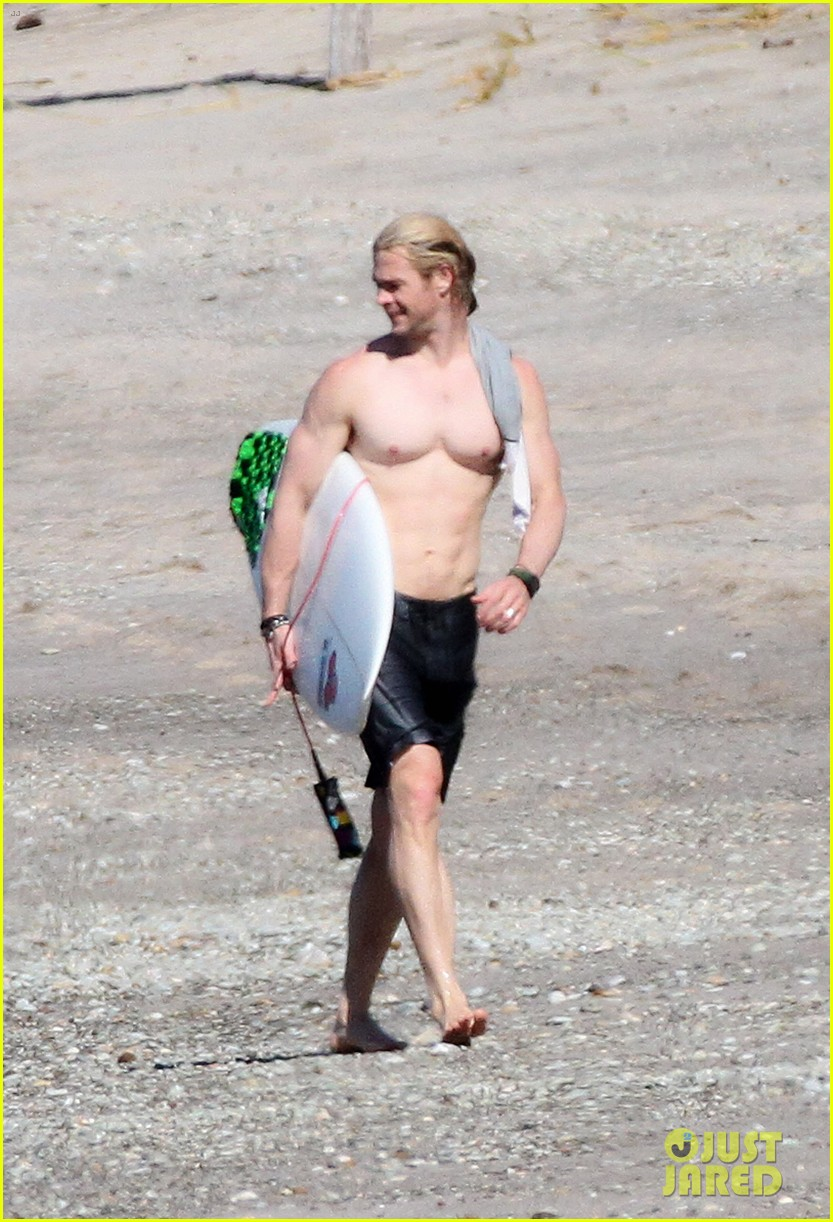 chris liam hemsworth shirtless surfing duo 03