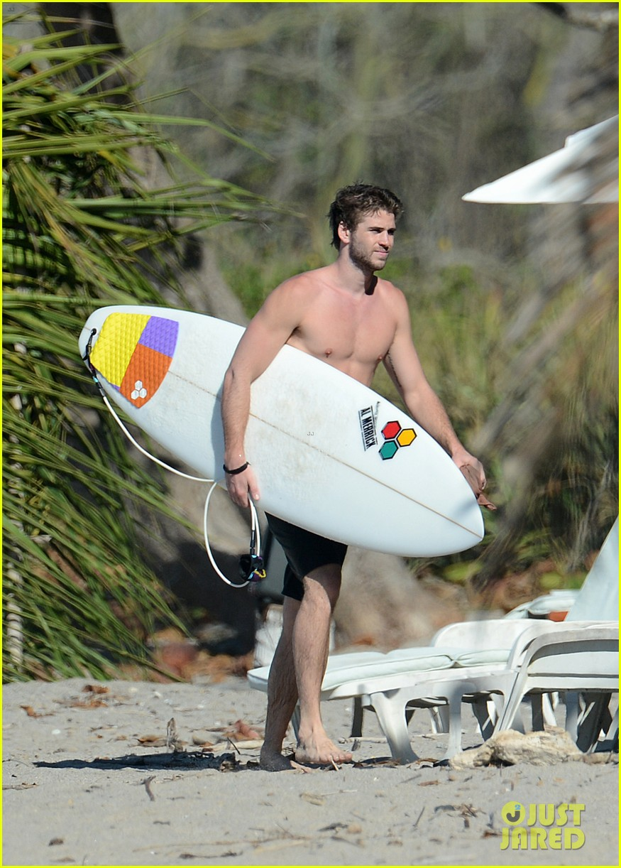 chris liam hemsworth shirtless surfing duo 462799423