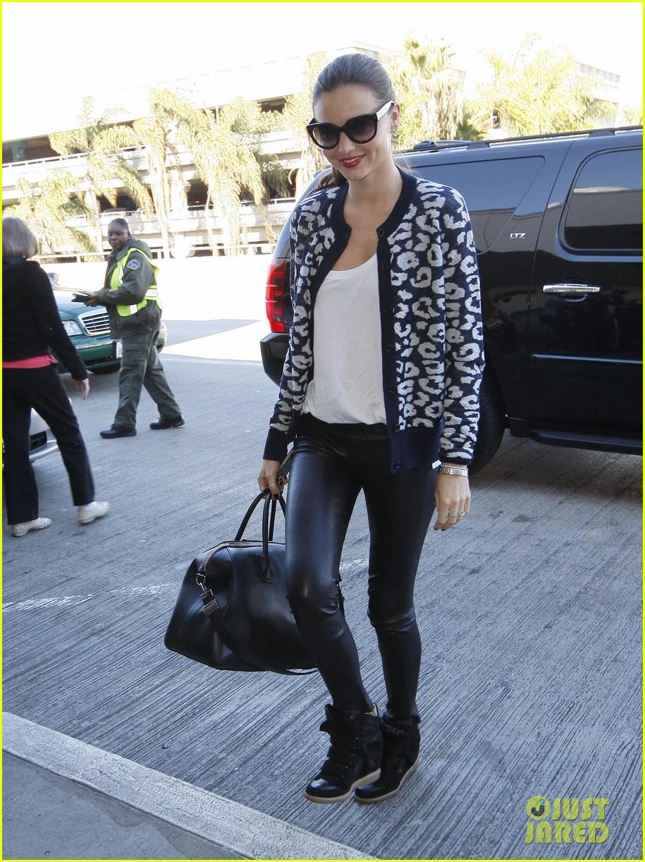 miranda kerr fashionable airport arrival 09