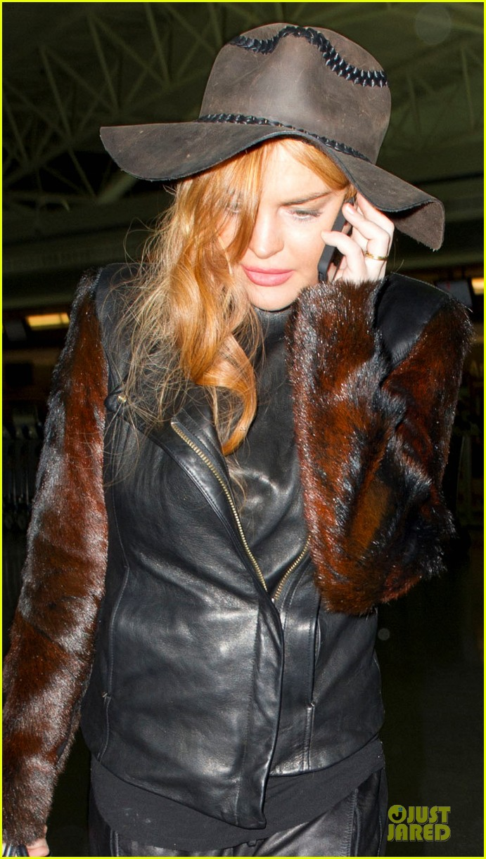 lindsay lohan departs jfk airport for court appearance 04