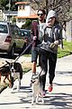 miley cyrus hoodie walk with pet pooch 14