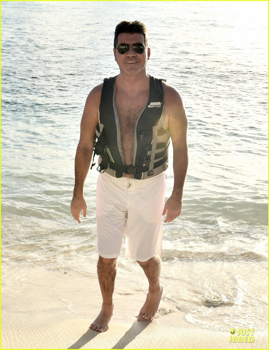 simon cowell shirtless new years eve with mezhgan huissany 23