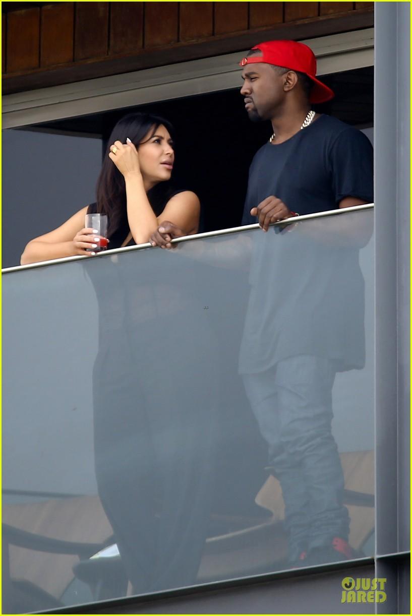 pregnant kim kardashian kanye west kisses in rio de janeiro 032807452