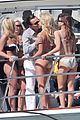 leonardo dicarprio kisses swimsuit clad girl for video shoot 06