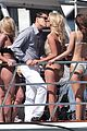 leonardo dicarprio kisses swimsuit clad girl for video shoot 07