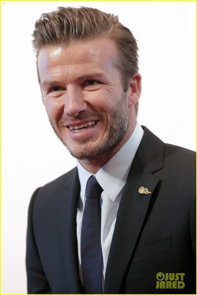 david beckham flashes shirtless body at university visit 212836852