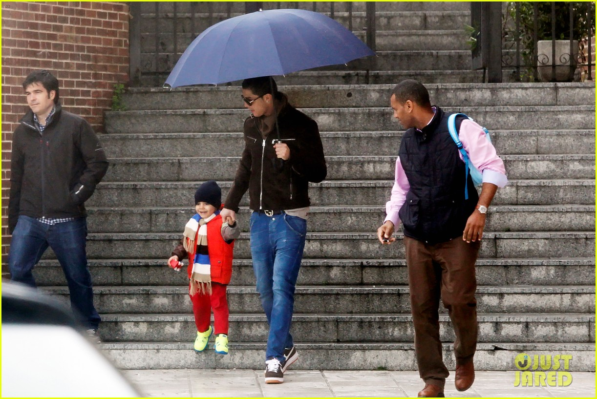 cristiano ronaldo rainy madrid day with cristiano jr 05