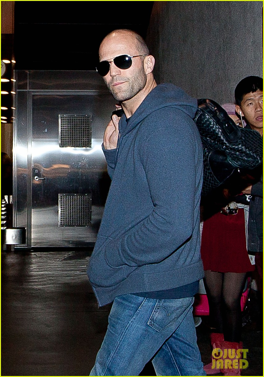 rosie huntington whiteley works out jason statham arrives at lax 04