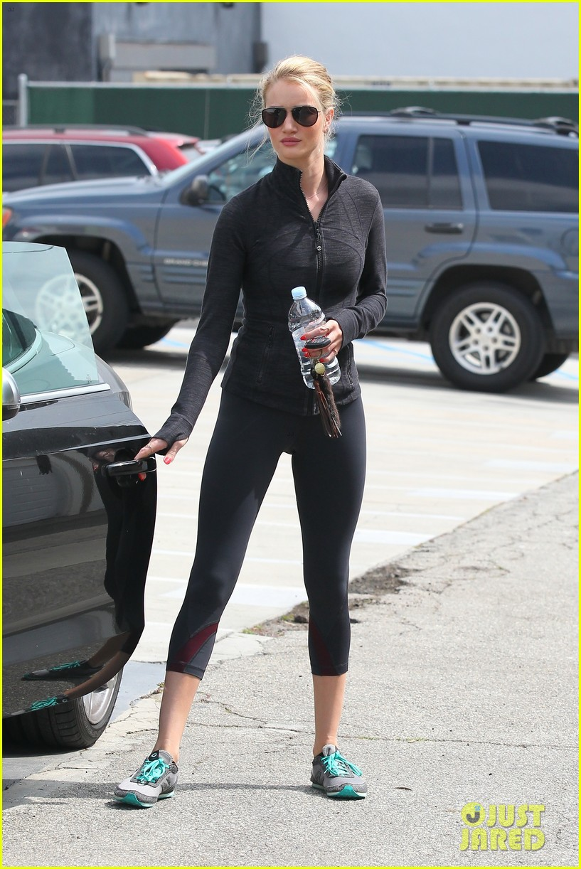 rosie huntington whiteley works out jason statham arrives at lax 09