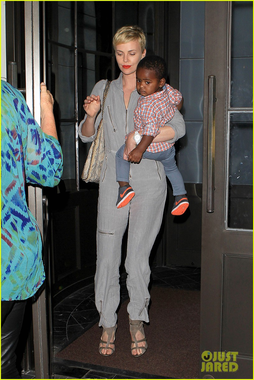 charlize theron rocks jumpsuit for dinner with jackson 062860603